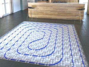 plancher chauffant avec dalles à plots